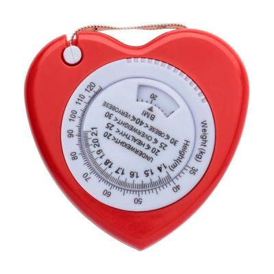 Image of Plastic, 1.5m, heart shaped BMI tape measure, includes a weight (KG) and height (Mts.) indicator on the front